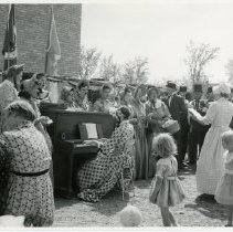 Image of Solway 60th Anniversary Celebration - Celebration for the 60th Anniversary of Solway, 1958. Women and men singing and dressed in costume. Children in picture. Woman playing the piano.