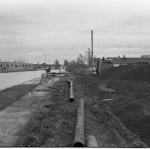 Image of Midway Drive, Bemidji Lakeside Motel, Paul Bunyan Motel - Midway Drive, Bemidji; Lakeside Motel, Paul Bunyan Motel,  November 5, 1955. Photo also shows road or sewer infrastructure construction work.