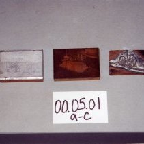 Image of 00.05.01 a,b,c - Printing blocks made of lead and copper attached to wood. A= Farm-All tractor with pulled diskharrow, which picked up spread straw B= Pull-type combine (model 42) which threshed wheat and spread straw behind C= Horsemower.  The lever raises and lowers