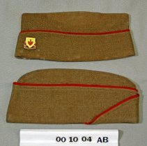 Image of 00.10.04 a,b - Korean War Uniform Hat.  Two identical hats.  Horizontal red stripe runs along the hat.   (Envelope style hat)