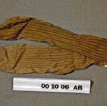 Image of 00.10.06 a,b - Korean War Uniform Socks. One pair of ribbed tan socks.