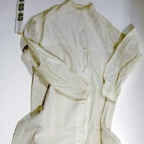 Image of 00.30.40 - Long white cotton nightgown with lace trim and full button front.  French knots in yoke (13 buttons).  Spot washed.
