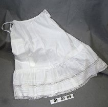 "Image of 01.05.04 - Drawstring waist.  Two lines of embroidered lace along the bottom hem.  Slip is gathered about 12"" above hemline."