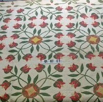 Image of 01.07.01 - Tulip pattern quilt.  Green leaves border red tulips with yellow centers.  From Senator George B. Keezell's home (grandfather to the donor)                                                                                                                     3/17/2012--quilt turning 7/25/2015--quilt turning