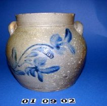 "Image of 01.09.02 - Stoneware Squat pot with blue cobalt floral decoration.  Flower design on front and back.  Salt-glazed on interior and exterior.  Two handles attached near rim.  Lip is 1"" high."