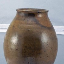 Image of 01.15.06 - Redware jar from Zigler pottery.  Simple design.  Widens at center.  Unmarked.  Small rim at top.