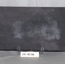 Image of 00.15.06 - Cast iron griddle with handle on each end.                                                                                                                                                                                                       17 inches x 9 inches. slight ridge on the bottom.