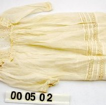 Image of 00.50.03 - Child's dress, white cotton with 14 tucks around bottom and tape lace inserts.
