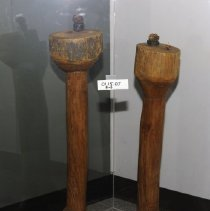 Image of 01.15.07 a,b - Pair of nutcrackers (his and hers).  Crackers rise to arm height when one is seated.  The base is large in relation to the stand to support the weight of the crackers.  The top is a flat area where the nuts could be cracked.  A small walnut holder is pla