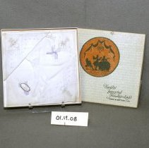 """Image of 01.19.08 - A)  Hankie box has cream background.  Front circle of the silouhette of three people in balck against orange background beneath a chandelier entitled  """"La lecon de danse""""  [the lesson of dance]   """"For Aunt Mabel"""" written on back """"3636"""" pencilled in corne"""