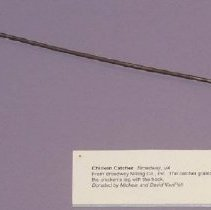 """Image of 01.21.01 - Turkey catcher.  Handle is wooden, edges are squared.  Reads """"Feed Grow- Big & Harco Feeds"""" and """"Broadway Milling Co., Inc. Broadway, VA"""".  Long metal bar (1/8"""" diameter) stretches out, the last 3 1/2"""" the bar curves in on itself to form a hook."""