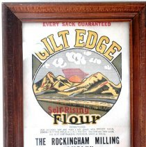 "Image of 01.25.03 - Framed Flour Bag, Gift Edge from Rockingham Milling Company.  Reads ""  Every sack guaranteed, Self-rising flour.  Directions:  Add necessary lard and make a soft dough with sweet milk, fresh butter milk, or cold water.  Roll thin and bake quick.  Do NOT"