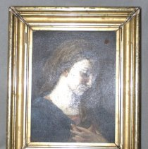 Image of 00.09.01 - Oil painting of a Madonna.  This vertically oriented oil painting on masonite or board depects what appears to be Madonna.  She is shown in a bust portrait in almost three-quarter frontal view, facing to the viewer's right. 
