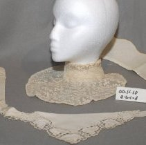 Image of 00.11.10 a-d - four white dress colllars for women a= white cotton with a scalloped edge b= white collar:  two half circles, dotted with ruffles on edge c= white flace flower pattern d=  two triangular pieces with tulip decoration on bottom.
