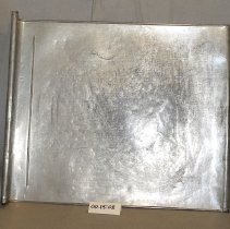 Image of 00.15.10 - A bread baking sheet with a rolled edge on the end.