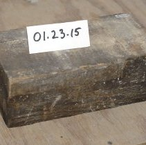 "Image of 01.23.15 a,b,c - wooden ""brick"".  These were used in place of brick beside opening for doors or windows in the house.  The doors and windows could be hammered and attached to the wood.  They would be scattered in with the ""normal"" brick at the crucial locations, such as"