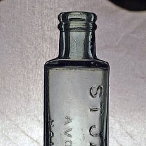 Image of 05.05.02 - Aqua cylinder bottle blown in mold with hand-formed top. Embossed:  ST JACOB'S OEL  / A VOLGELER & Co / BALTIMORE MD