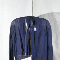 "Image of 06.05.06 - Long sleeved sheer navy crepe jacket was worn over a straight  dress.  Jacket  is 30"" center back from collar to hem.  Collar forms long ties to be tied at neck.  Hem is a band that is closed in front with a silver colored ornament with rows of blue and clear stones."