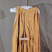 "Image of 06.05.07 - Tan Split riding skirt measuring 32 1/2"" length and 26"" waist.  Tears and discolored"