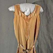 "Image of 06.05.13 - Sleeveless Gold crepe and satin dress measuring 49"" long.  Cut on bias with dropped waist.  Satin fabric tie belt with a rinestone buckle.  Deep ""V"" neck in front and back"