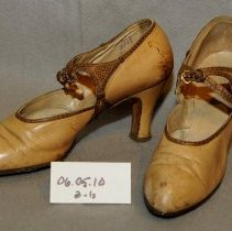 "Image of 06.05.10 - Pair of tan 3"" high heel shoes with applied brown trim on side and forming strap at ankle.  ""Queen Quality, Baltimore, MD."