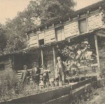 "Image of Photo0029.jpg - Old log homestead with four unidentified men in front.  I.E. Terrell in ""Old Homes in Rockingham County"" notes that the house was located near Trissel's Mennonite Church in the Northwestern part of the County.  Brock's Gap written on back."