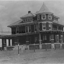 Image of Photo0103.jpg - Three story, brick Victorian, with wire fence in the foreground.  The Joseph house.