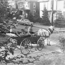 Image of Photo0128.jpg - Man in horse drawn wagon turning onto High St. from Elizabeth St. in Harrisonburg.                                                                                                                                                                              1959 photo of Charlie Strawderman, perhaps the last wagon to be seen on H'burg Streets