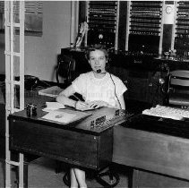 Image of Photo0129.jpg - Nancy Flippo, telephone operator, at her desk