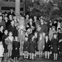 Image of Photo0177.jpg - Group of people surrounding Santa Claus