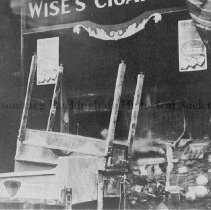 Image of Store window of Wise's Cigars.