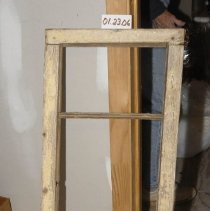 Image of 01.23.06 - Transom window, origially had four sections, but center bar is missing.  Held together by wooden pegs (no nails were used)