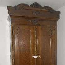 Image of 03.01.863 - Walnut and oak wardrobe with two doors with locks and two drawers.  Inside has one hanging bar and one shelf, divided in half.  Ornate pieces are attached to the front top center.  Front of doors are built out.  Good condition.
