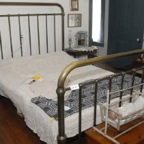 Image of 03.01.865 - Brass bed frame with head board and foot board, steel frame on rollers.  Good condition.