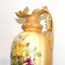 """Image of 03.01.905 - Yellow and tan vase with two red and one yellow rose on front, and five red rosebuds with green leaves on front.  Lighter color in the center.  Bottom of vase says: """"Made in Austria/Royal/Wettina"""".  Niece of Mable Spitzer's father gave vase to Mabel for a wedding present, her name was Liza Groot.  Good condition."""