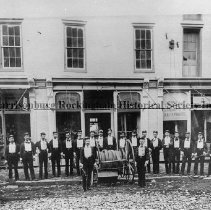 Image of Photo0054.jpg - Harrisonburg Volunteer Fire Dept., Reel Co. #2, in front of the Spotswood Hotel in Harrisonburg.  The Harrisonburg Shoe Co. and the Palace Shaving, hair cutting and bath parlors in background