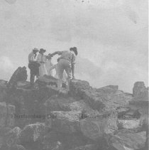 Image of Group of people hiking over rocks