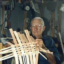 Image of Photo3049.05.jpg - Elmer Price, Sr. forming the base of a basket
