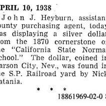 Image of John J. Heyburn displays a silver dollar, 1938