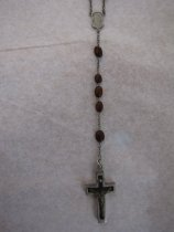 Image of part of rosary that has cross and five beads on extra chain