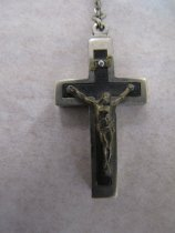 Image of Full view of cross with Christ and scroll with nail through it