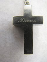"""Image of Back of Cross with """"Roma"""" across it"""