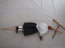 Image of back of marionette