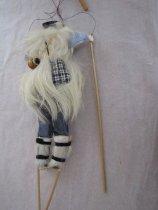 Image of Back of puppet with gourd and pouch