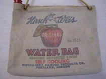 Image of Water Bag with red cap on top left showing