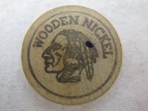 Image of Front of nickel with stain near feather