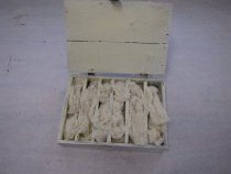 Image of inside of lid and box with wool over the eggs