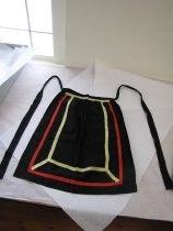 Image of full view of front of apron and its ribbon to tie around waist