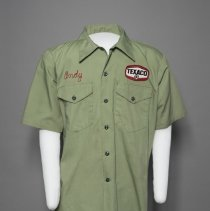 """Image of Green Texaco uniform with name """"Andy"""" sticthed in right breast; c.1960"""