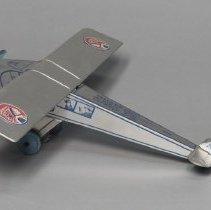 Image of Toy airplane, silver metal with blue and red details; c.1930